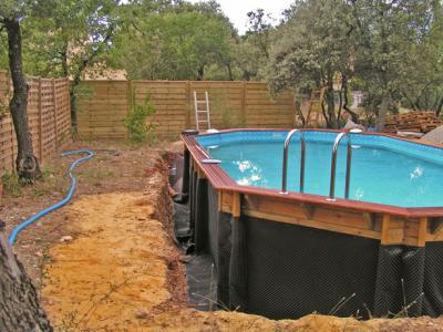 mise en place de la protection construction d 39 une piscine bois. Black Bedroom Furniture Sets. Home Design Ideas