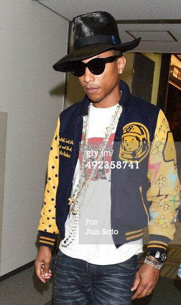 Pharrell & Helen - Aéroport de Narita - Japon - 20 mai 2014