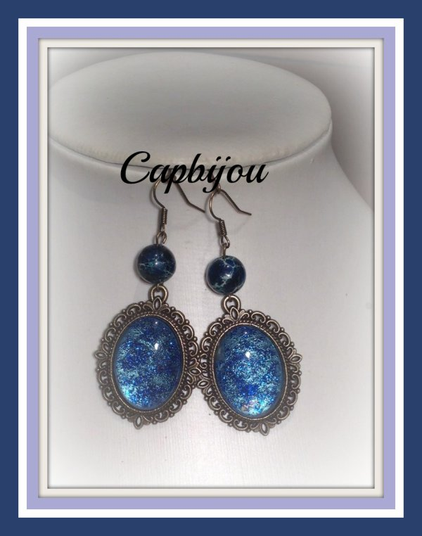 boucles d'oreilles bronze aux  reflets bleus paillet�s