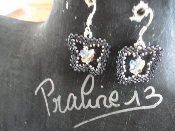 une paire de boucles d'oreilles papillon, inspir�es d'une cr�atrice italienne