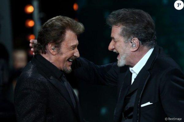 Johnny Hallyday et Eddy Mitchell complices au restaurant après leur concert