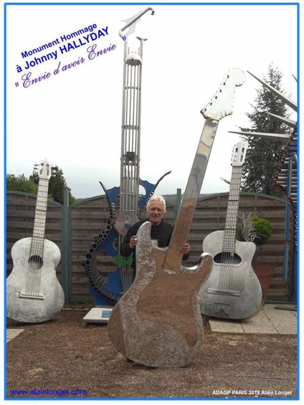 Monument hommage à Johnny HALLYDAY 5 mètres de haut tout inox en cours de réalisation par le sculpteur www.alainlonget.com . la guitare électrique en premier en cours de réalisation .