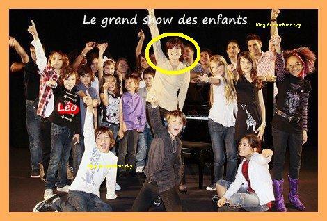"""Léo Rispal a participé à l'émission """" LE GRAND SHOW DES ENFANTS """" Sur TF1 c le garcon qui est ecrit sur lui leo"""