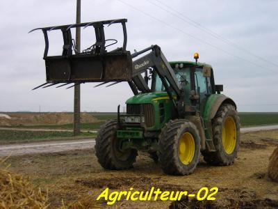 John deere 7530 avec fourche quick q75 machinisme agricole - Tracteur avec fourche ...