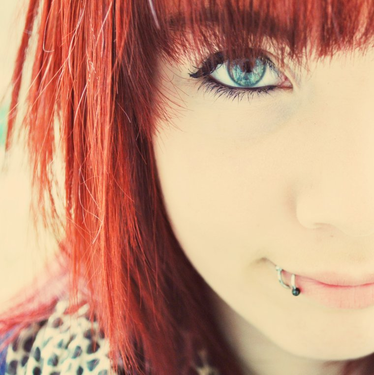 Red color hair.