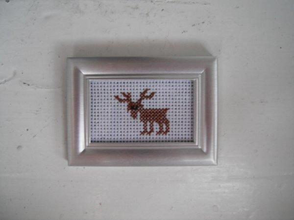 j'ai encadré  mon petit cerf dans un cadre magnétique.