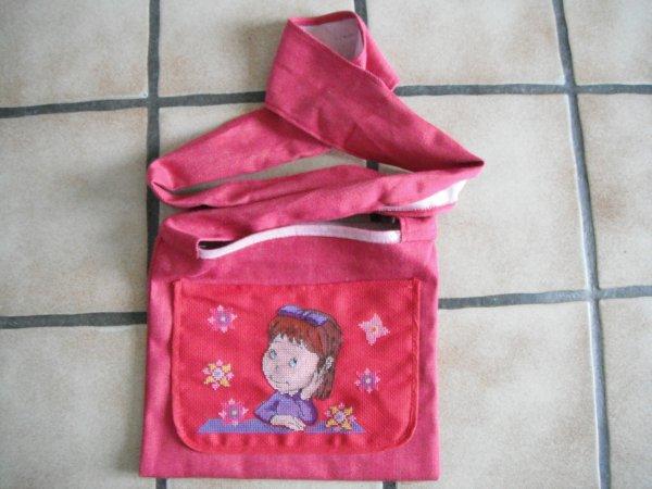 voici le manége enchanté sur un petit sac.