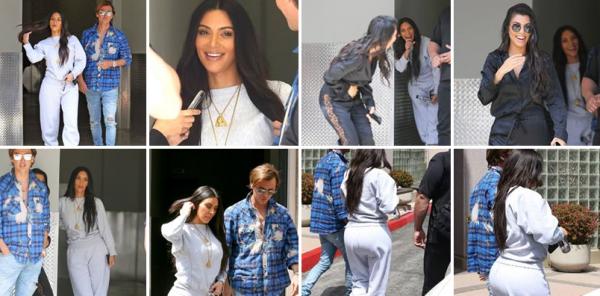 Kim, son meilleur ami et Kourtney ont été vus se balladant à Los Angeles. Kim est tout en gris, mais peu importe, elle est toujours aussi belle !
