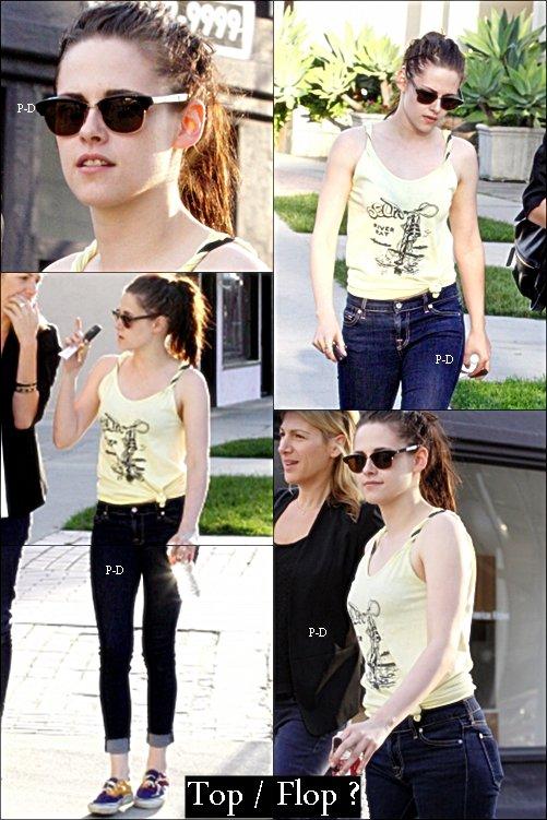 23 Février: Kristen et son agent publicitaire faisant du shopping chez Balanciaga. Pour moi c'est Top, sa tenue est simple mais j'aime bien :)