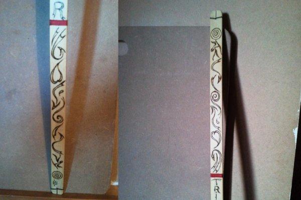 J'ais dessiné et pyrogravé l'arc de mon petit fils Titi.