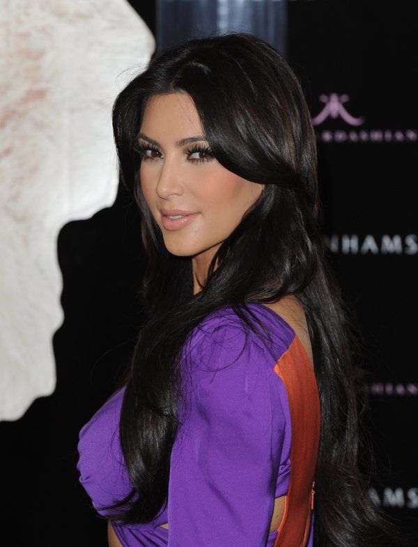 Kim at her fragrance launch afterparty (06/08)