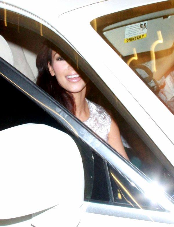 Kim leaves a hotel (08/21)