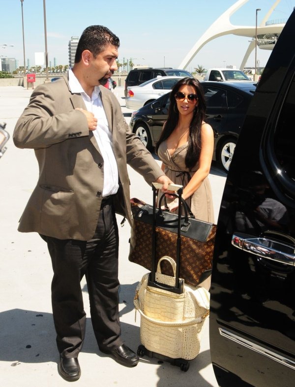 Kim & Kris Humphries were pictured  making their way through LAX airport to catch a flight to Europe (08/22)