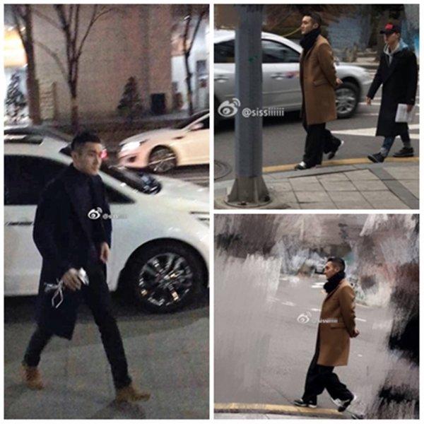 Siwon  en train de se promener dans les rues de Seoul