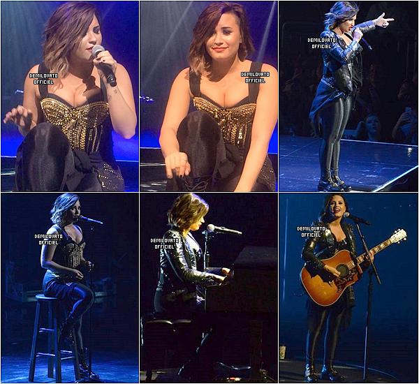 14.09.2014 - Demi a été vue en train de bronzer au bord de la piscine de son hôtel à Miami.