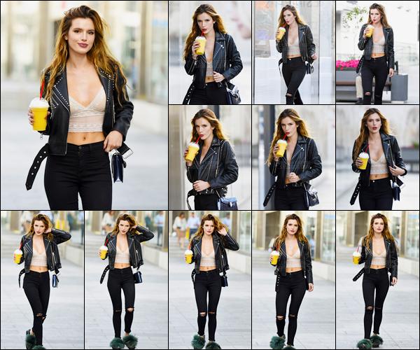 - ..14/06/16.. -  Notre jolie Bella Thorne a été photographiée dans une rue de Los Angeles, boisson à la main.Coup de coeur pour cette magnifique tenue qui respire le rock. Seul bémol, ses espèces d'horreurs à poils qu'elle porte aux pieds. #WhatTheFuckB. -