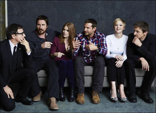 . Le cast d'American Hustle est en couverture de Wrap Magazine du mois de décembre 2013 .