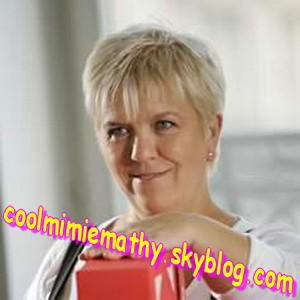Article presse/interview     Mimie Mathy joue une célibataire  $).