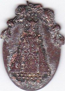 émouvante médaille religieuse trouvée parmi des boutons d'uniformes à Etaples sur Mer (62)