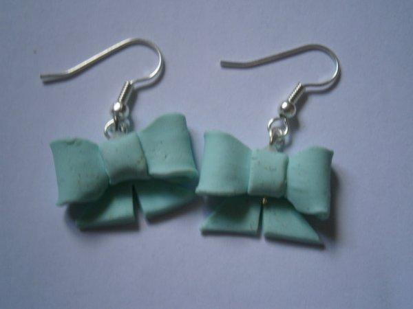 ARTICLE 78 : Boucle d'oreilles n½uds bleus.
