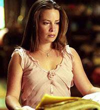 petite presentation de holly marie combs ( piper )