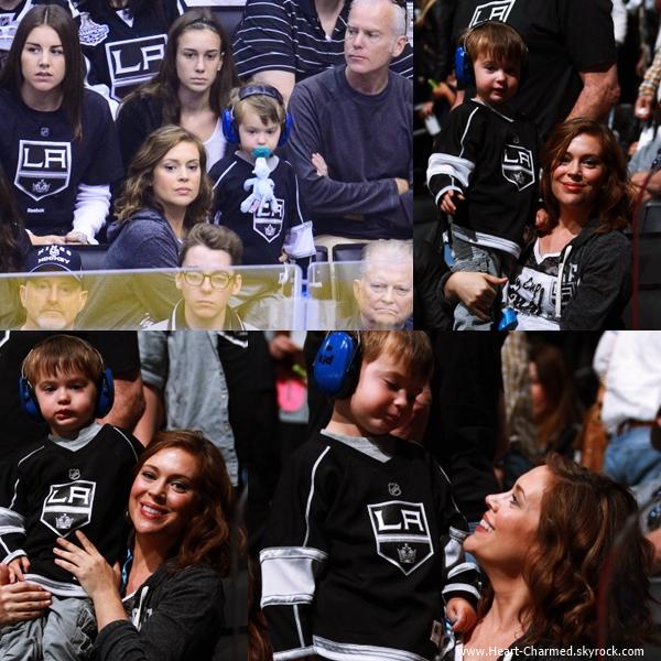 -    07/06/2014 : Alyssa assistant avec son fils Milo à un match de la NLH à Los Angeles.  -
