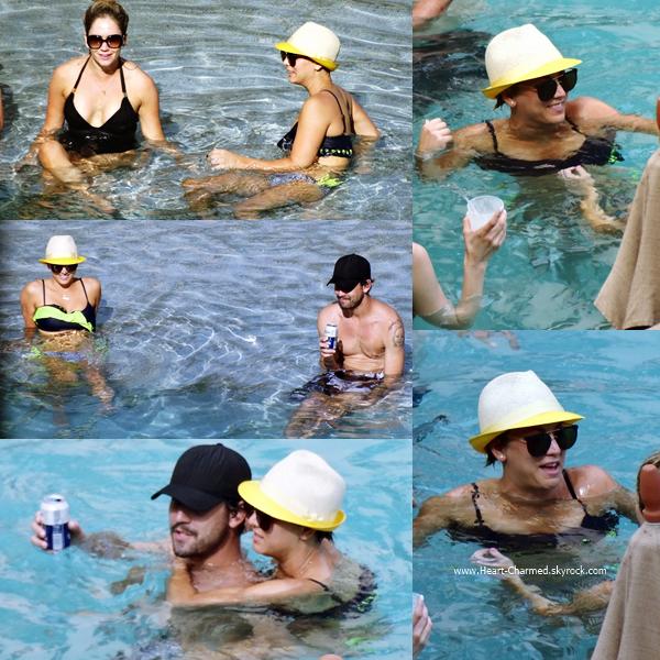 -    03/07/2014 : Kaley et son mari Ryan Sweeting profitant de leurs vacances au bord d'une piscine de Mexico au Mexique.  -