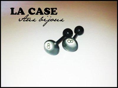 Piercing langue en bioplastic 1.6x6mm. Disque logo 8mm. 4¤ l'unité.