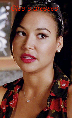 Santana, chemise noir a fleurs rouges