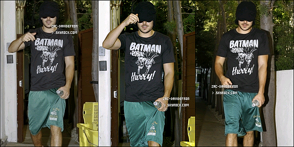 .  27/09/10 - Zac  s'est caché derrière son bonnet , avec son t-shit Batman en sortant d'un salon de B.H. .