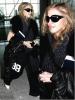 Madonna : Aucune modification n'a été effectué sur cette photographie ! Que ce soit coloring ou autre, cette photographie est authentique ! lol  Teint pâle, jogging extra large noir , lunette Dolce Gabbana noir ( et heureusement, sinon les dégâts auraient pu être pire ! ), foulard bleu noir & veste en cuir noir ...  Tous ça pour vous dire que Madonna n'était pas au top de sa forme ce jour là ...
