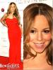 """Mariah Carey : Glamour en rouge, assortis au red carpet, elle était présente lors du """"Noble Gift Gala"""", un Gala qui rend hommage aux personnes qui aident à favoriser la sensibilisation des enfants et l'autonomie des femmes dans le monde. Mariah a d'ailleurs reçu le prix 2011 de cette cérémonie pour ses engagements ."""