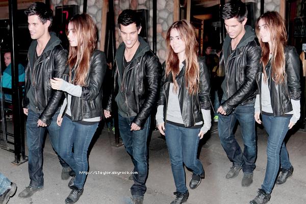 __07/04/11  Taylor quittant un restaurant avec Lily Photos,