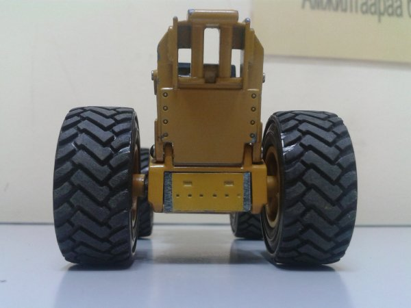 55 - Skidder Caterpillar 545 avec roues chargeuse Cat 980G par Norscot
