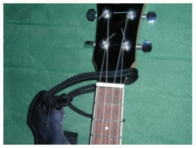 comment mettre sangle ukulele