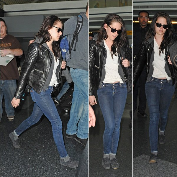 (152)18/03/2012● Kristen à l'aéroport de Los Angeles pour aller à New York  La raison: L'émission télé The Today Show en compagnie de Charlize