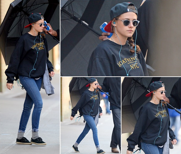 (628)23/03/2014 .22 MARS. › Kristen quittant son hôtel à New York.