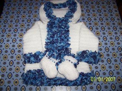 manteau a bouclette tricoté au crochet