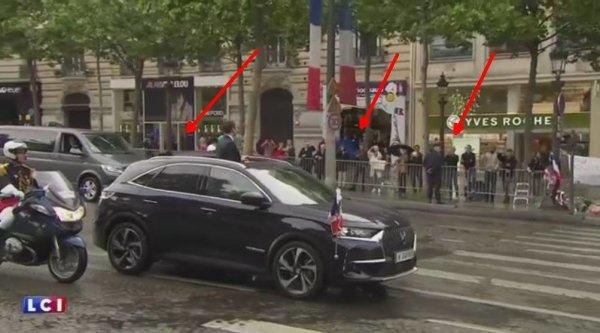 NOUVEL ORDRE MONDIAL SATANIQUE NAZI :Macron remonte les Champs-Élysées en saluant une foule inexistante