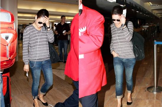 Candids de Mila datant du 29/08 à l'aeroport LAX . Coté tenue : c'est un TOP ! J'adore son tee-shirt et son jean est basic mais je n'aime pas trop ses ballerines noires  .