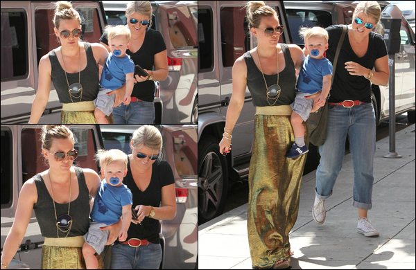 . 15/03/13 : H. se consacrant à son activité favorite avec son petit Luca et une amie. .Non pas du sport, mais bien du shopping !.