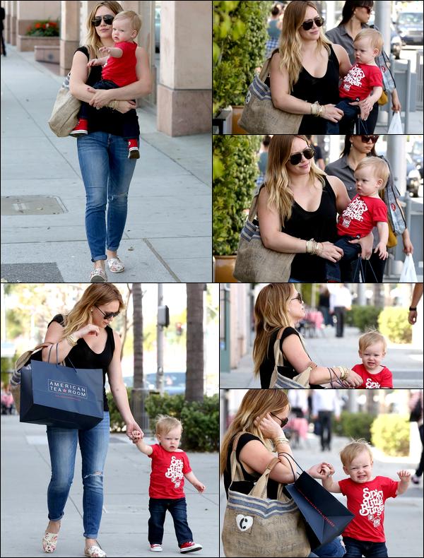 . 21/03/13 : La belle maman Hilary allant avec bébé Luca faire chauffer sa carte de crédit dans des boutiques de Beverly Hills....