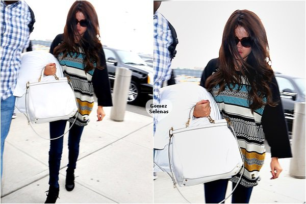*   30.06.13 - Selena, pas très souriante arrivant à l'aéroport de New York direction Boston.  *