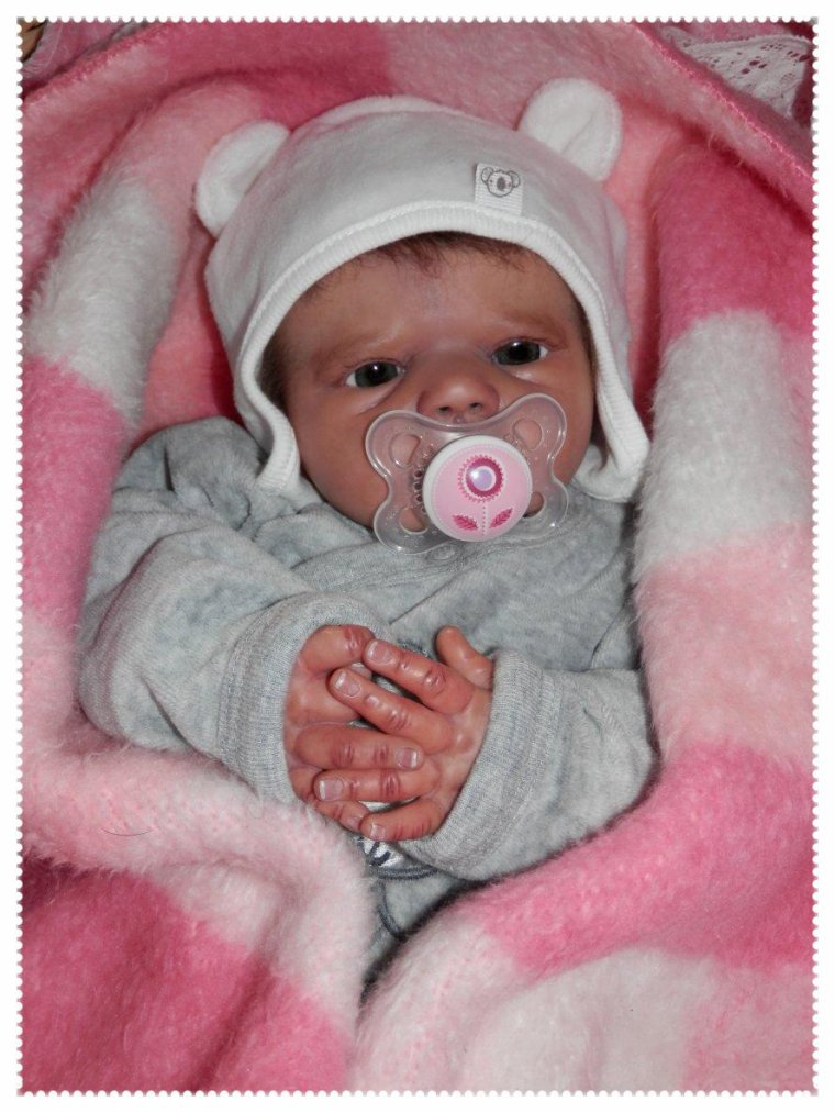 Lily-Rose bien au chaud par ce temps froid ..