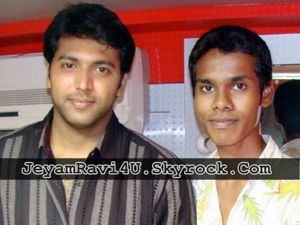 jeyam ravi with a fan