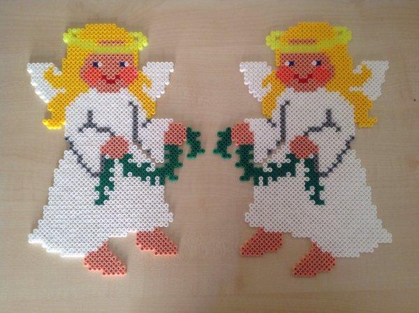 Décoration de mes deux anges ils messure 28 cm hauteur sur 20 cm largeur .