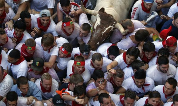 Spain Running of the Bulls Festival carnival people