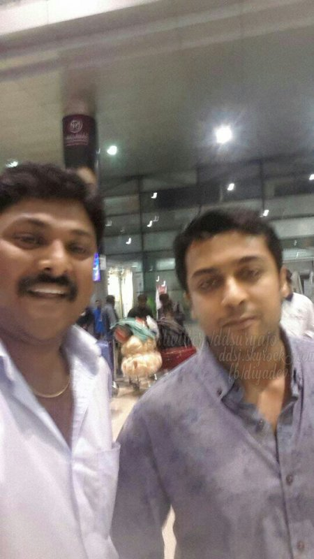 Suriya with fans at hyderabad airport when he was there for chiranjeevi birthday party