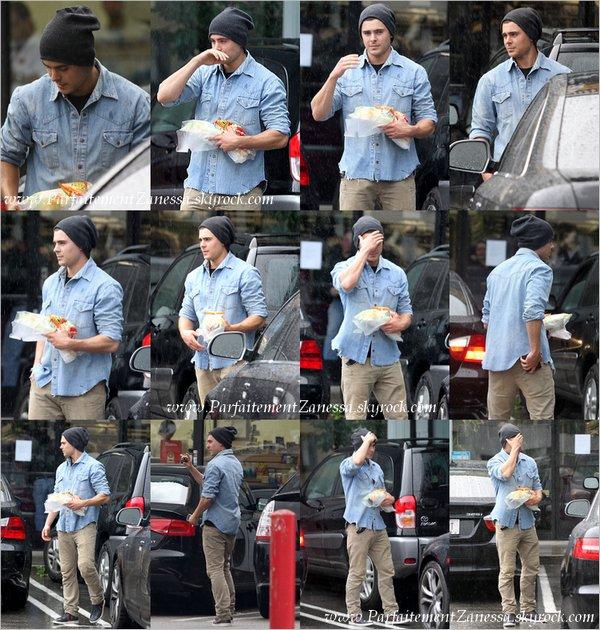 22.12.2010 // Monsieur Efron est de retour à Los Angeles puisqu' il a terminé de tourné son film « The Lucky One », il a été photographié sous la pluie sortant d' un Subway ( une sandwicherie )