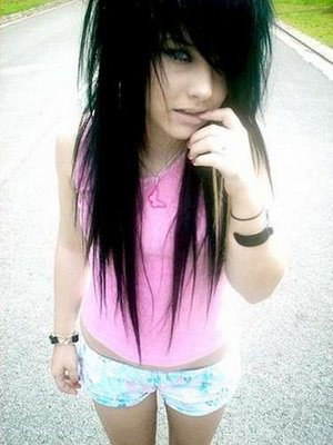 nice clothes-nice bracelet- she s cute an' sexy - and of corse A LONG CUTE EMO HAIR :)